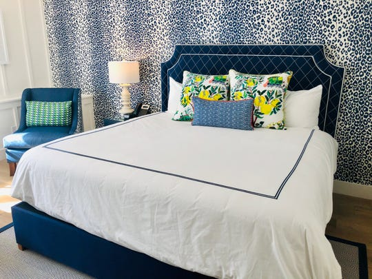 This navy blue, leopard-inspired patterns is one of four room motifs at The Mackinac House.