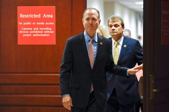 House Intelligence Committee Chairman Adam Schiff, D-Calif., followed by Rep. Mike Quigley, D-Ill., walks out to talk to reporters on Capitol Hill in Washington, Wednesday, Nov. 6, 2019, about the House impeachment inquiry.