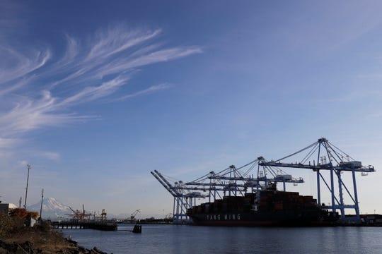 Cranes and a cargo container ship at the Port of Tacoma in Tacoma, Wash.