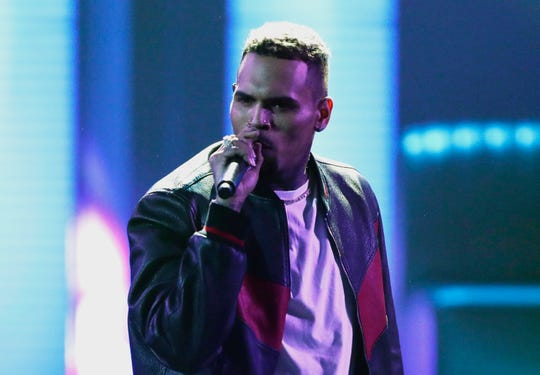 Chris Brown said he was having a high-end yard sale at his Los Angeles home, and a crowd has been gathering for hours.