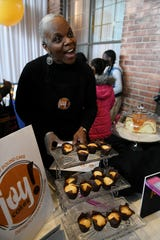 Delilah Reynolds of Joy! Cakes talks about how she came up with the pound cake and sweet potato pie combination at the TCF Bank neighborhood day party at the North Rosedale Community House in Detroit on Nov. 6, 2019.