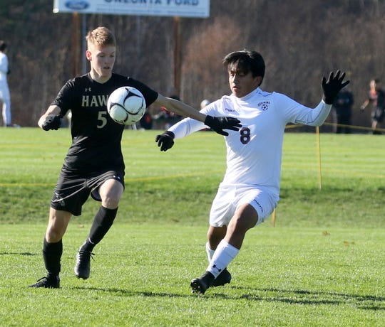 Corning's Micah Cornfield (5) and Ossining's Andrew Inga (8) battle for possession during a Class AA boys soccer regional semifinal Nov. 6, 2019 at the Wright National Soccer Campus in Oneonta.