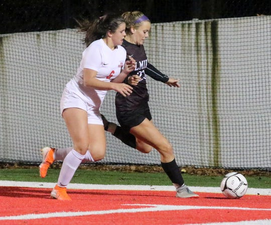 North Rockland's Megan MacMillan, left, and Elmira's Madisyn Ross battle for possession during a Class AA girls soccer regional game Nov. 5, 2019 at Waverly Memorial Stadium.