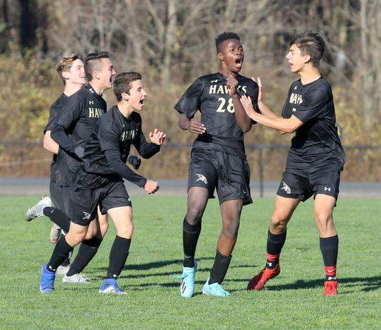 Corning celebrates a tying goal from Preston Ogunwumi, second from right, during a Class AA boys soccer regional semifinal against Ossining on Nov. 6, 2019 at the Wright National Soccer Campus in Oneonta.