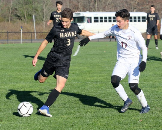 Corning's John Greene (3) is defended by Ossining's Andrick Palma during a Class AA boys soccer regional semifinal Nov. 6, 2019 at the Wright National Soccer Campus in Oneonta.