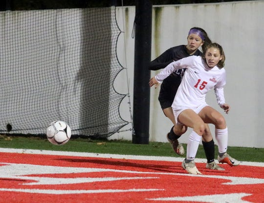 North Rockland's Sophia DeEsposito (15) and Elmira's Emma Pack chase after the ball during a Class AA girls soccer regional game Nov. 5, 2019 at Waverly Memorial Stadium.