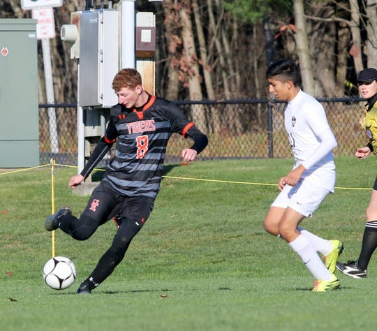 Union-Endicott's Joshua Mollo kicks the ball ahead as Rye's Amar Jaswal defends during a Class A boys soccer regional semifinal Nov. 6, 2019 at the Wright National Soccer Campus in Oneonta.