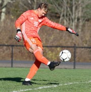 Corning goalie Griffin Huff boots the ball during a Class AA boys soccer regional semifinal Nov. 6, 2019 at the Wright National Soccer Campus in Oneonta.