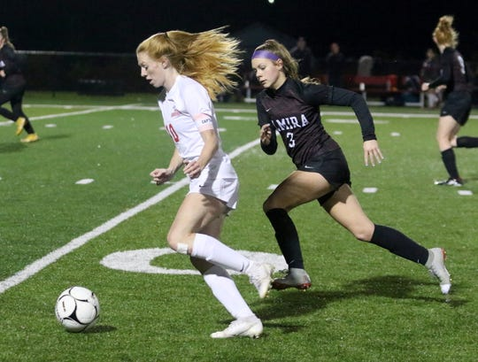 Kelly Brady of North Rockland dribbles the ball as Elmira's Jodee White defends during a Class AA girls soccer regional game Nov. 5, 2019 at Waverly Memorial Stadium.