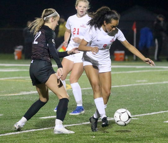 Logan Valdes of North Rockland controls the ball as Elmira's McKenna Ross defends during a Class AA girls soccer regional game Nov. 5, 2019 at Waverly Memorial Stadium.