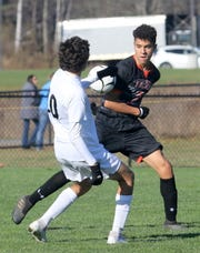 Rye's Jonathan Mehrara, left, and  Union-Endicott's Luke Taylor battle for possession during a Class A boys soccer regional semifinal Nov. 6, 2019 at the Wright National Soccer Campus in Oneonta.