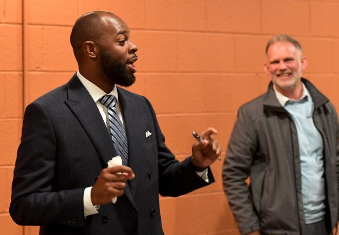 Fourth ward winner, Alex Burton with third ward winner Zachary Heronemus beside him speak to the crowd as the democrats gather at DiLegge's to watch the election night returns Tuesday evening, November 5, 2019.