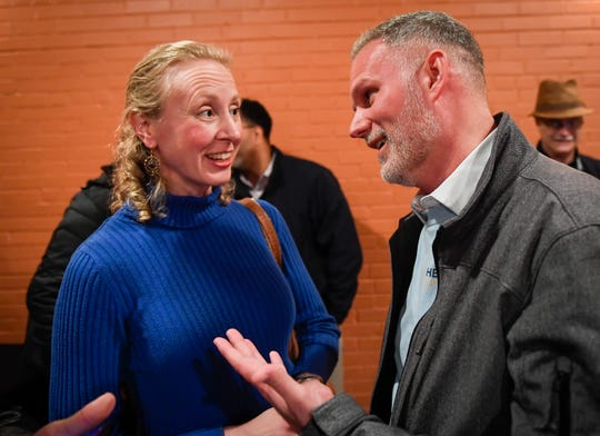 Gina Robinson Ungar talks with third ward winner Zachary Heronemus as the democrats gather at DiLegge's to watch the election night returns Tuesday evening, November 5, 2019.