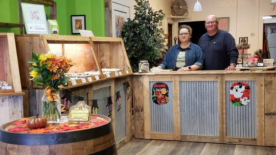 DeAnn and Mike Schmitt renovated their new storefront with wood and fixtures that have great emotional value to them.