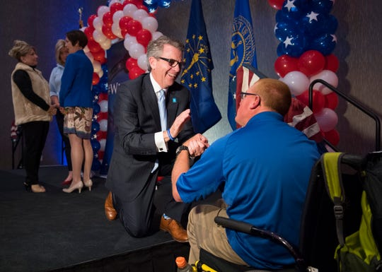 Evansville Mayor Lloyd Winnecke, left, is congratulated by Kenny Page, right, during the republican watch party at the Doubletree by Hilton in Downtown Evansville, Ind., Tuesday evening, Nov. 5, 2019. Winnecke earned 8o percent of the votes making him Mayor for a third consecutive term.