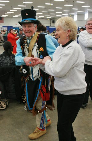 Dick Welch, left, of Fond du Lac, a Brothertown Indian Nation Elder and storyteller, danced with Nancy Miller, of Fond du Lac at CELEBRATE commUNITY. The event is held annually at Fond du Lac County Fairgrounds.