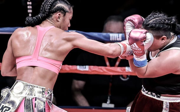 Alycia Baumgardner lands a left against Annette Pabello in a fight last Saturday in Tampa. Baumgardner won the six-round bout in a unanimous decision.