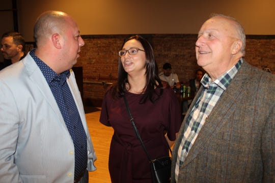 Fremont Mayor Danny Sanchez, pictured left, talks with his wife, Jessica, and local business owner Tom Kern Tuesday night at the Live Edge Center prior to election results being released. Sanchez was reelected in a landslide over independent challengers David Roca and Andy Roberts.
