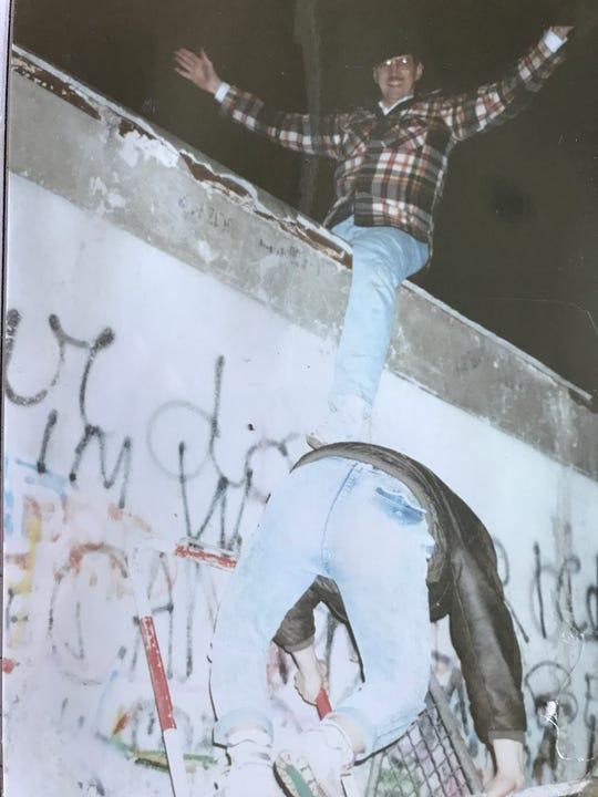 Milt Garrett atop the Berlin Wall in 1989.