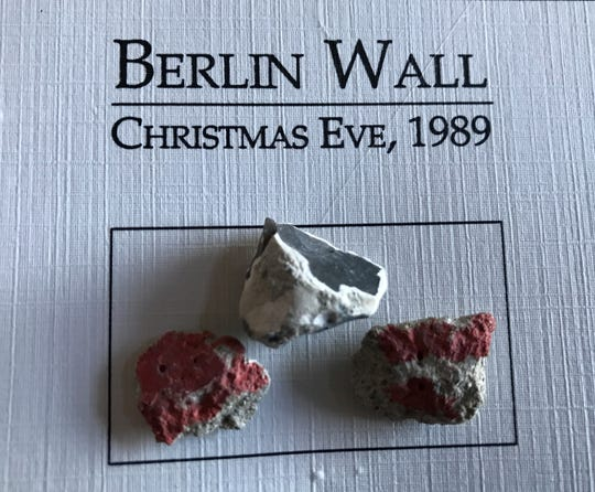 Pieces of the Berlin Wall on promotional material made by Milt Garrett.