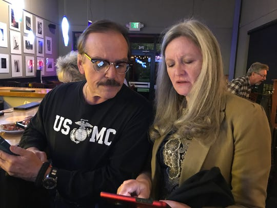 Gil Barela, manager of the Building a Better Larimer County campaign supporting Ballot Issue 1A, and County Manager Linda Hoffmann view early election results on Tuesday, Nov. 5, 2019, in Fort Collins.