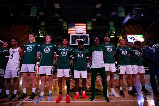 The Colorado State University basketball team looks on during the Star Spangled Banner before a game against the University of Denver on Tuesday Nov. 5, 2019, at Moby Arena in Fort Collins, Colo.