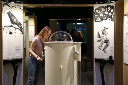 """The Worry Shredder, part of the """"Mental Health: Mind Matters"""" exhibit that will come to Fort Collins, allows visitors to write down their fears and therapeutically run them through a shredder."""