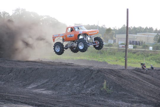 """The mega truck Hammerhead flies to victory in a scene from the TV series """"Dirty Mudder Truckers."""""""