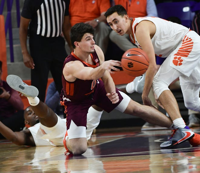 Clemson guard Alex Hemenway (right) defends Virginia Tech's Hunter Cattoor in the Tigers' loss on Tuesday night.