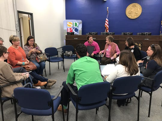 Parents formed small groups at a public input session to discuss the proposed 2020-21 calendar for the Pickens County school district Tuesday.