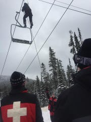 Members of the Great Falls Ski Patrol train during a chairlift evacuation exercise