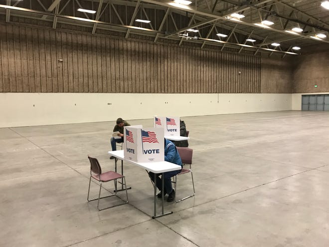 Voters cast ballots shortly before the polls closed Tuesday.