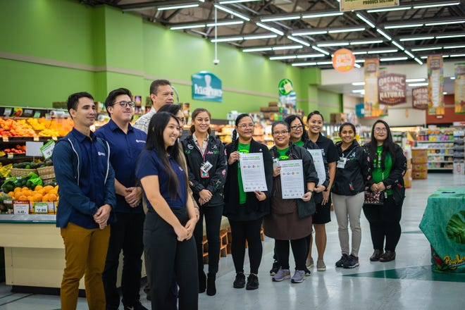 The managers of Pay-Less Markets Inc. show their newly signed 5-2-1-Almost None pledges alongside staff from the University of Guam's SNAP-Ed program.