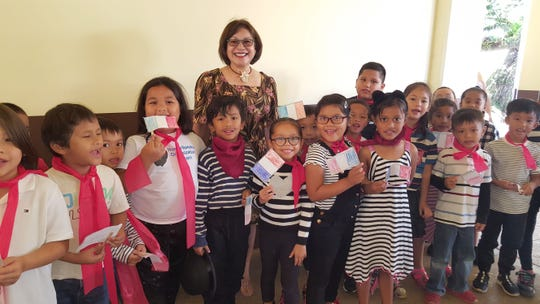 The Guahan Academy Charter School held a United Nations Day celebration on Oct. 31. Dr. Judith Won Pat, chief academic officer is pictured with first grade students.