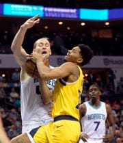 Nov 5, 2019; Charlotte, NC, USA; Indiana Pacers guard forward Jeremy Lamb (26) drives in as he is fouled by Charlotte Hornets forward center Cody Zeller (40) during the first half at the Spectrum Center.