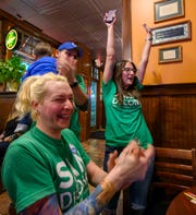 Samantha DeLong, right, reacts with campaign manager Sara Serna and her husband Joe DeLong after confirming her win in the Fishers City Council NC District race. The Hamilton County Democratic candidates gathered with supporters at Muldoon's in Carmel, to watch the results Tuesday, Nov. 5, 2019.