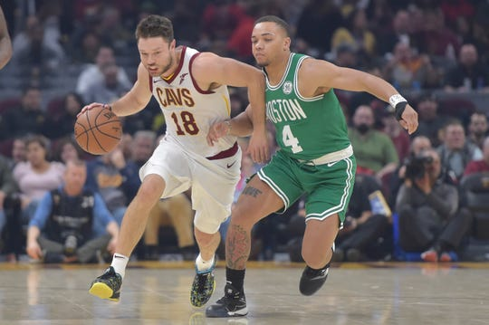 Nov 5, 2019; Cleveland, OH, USA; Cleveland Cavaliers guard Matthew Dellavedova (18) drives against Boston Celtics guard Carsen Edwards (4) in the second quarter at Rocket Mortgage FieldHouse.