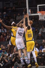 Nov 5, 2019; Charlotte, NC, USA; Charlotte Hornets forward center Cody Zeller (40) shoots defended by Indiana Pacers forward JaKarr Sampson (14) and center Goga Bitadze (88) during the first half at the Spectrum Center.