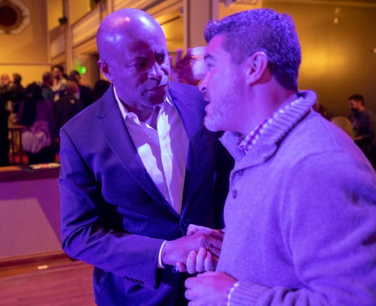 Vop Osili and Zach Adamson of the City-County Council talk during the evening's Democrat election night party, Indianapolis, Tuesday, Nov. 5, 2019.