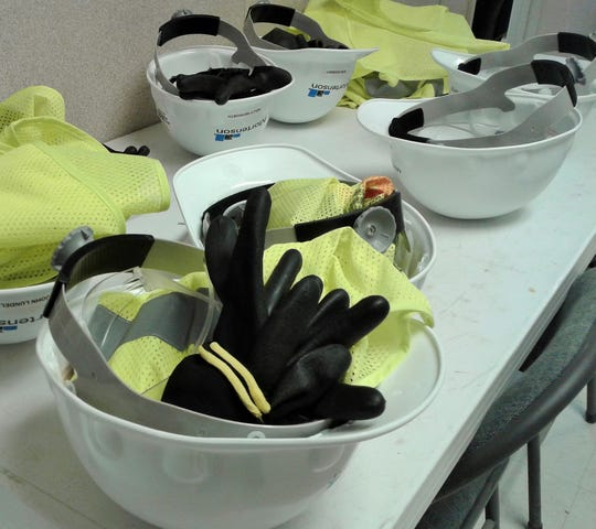 Extra hard hats with gloves and safety vests await visitors to the Coralville arena construction site in the temporary main office established here by Mortenson Construction.
