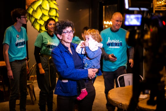 Janice Weiner does an interview while holding her granddaughter Alaska during a watch party for city council elections, Tuesday, Nov., 5, 2019, at Big Grove Brewery and Taproom in Iowa City, Iowa.