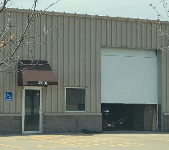 A garage door rests half-open at 390 Herky St. 3E, where Roy Browning Jr. apparently operated one of his past businesses, April 9, 2019, in North Liberty.