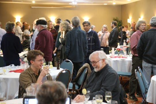 Residents filled a room at the Clarion Inn in Lansing during an election night watch party hosted by the Tompkins County Democratic Committee.