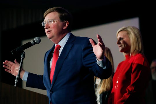 Mississippi Governor-elect Tate Reeves addresses his supporters, as his wife, Elee Reeves, right, listens, at a state GOP election night party Tuesday, Nov. 5, 2019, in Jackson, Miss. Reeves, the current lieutenant governor, defeated Democratic Attorney General Jim Hood in the race for governor (AP Photo/Rogelio V. Solis)