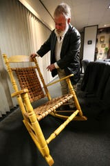 Chair maker Greg Harkins of Tupelo shows details of his work. He has given his rocking chairs to six presidents over his lifetime, the latest being President Donald Trump. Trump was in Tupelo on Friday, Nov. 1, 2019, for a rally before the Nov. 5 general election.