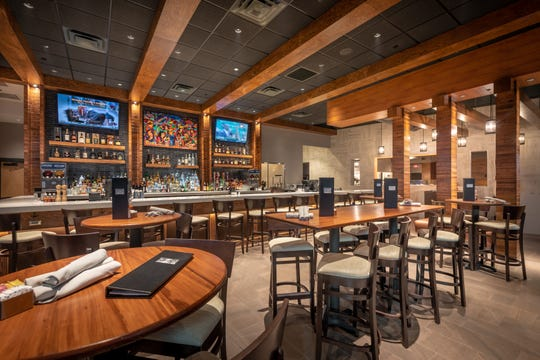 The 6,000-square-foot restaurant, which features a contemporary design with finishes in stone, tile and dark woods, can accommodate up to 229 customers in both indoor and outdoor areas. The restaurant patio includes a fireplace along with televisions, Wi-Fi and charging ports in the bar.
