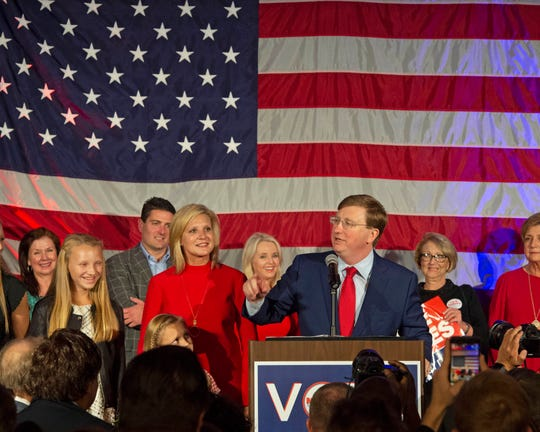 Surrounded by family and friends in the ballroom of the Westin Hotel in downtown Jackson, Miss., Tate Reeves gives a victory speech to his supporters. Reeves won the Mississippi gubernatorial race against democratic candidate Jim Hood in Mississippi on Tuesday, Nov. 5, 2019.