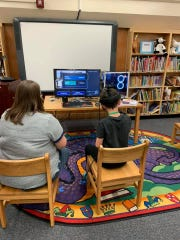 High-tech virtual reality was a hit at the Fossil Hunt at Norwood Elementary School.