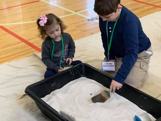 The McClung Museum supplied the sand and the fossils for the Fossil Hunt at Norwood Elementary School.