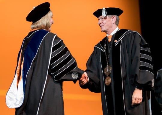 Interim UT System President Randy Boyd presents the Medal of Office to Chancellor Donde Plowman during the investiture at the UT Student Union Auditorium on Wednesday, Nov. 6, 2019.